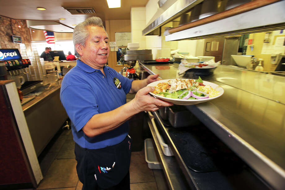 Lupe Plata works at his job as a server at Jim's Reataurant on Broadway near downtown  on July 16, 2013. Photo: TOM REEL