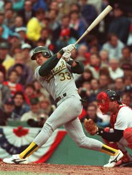 ** FILE ** Jose Canseco hits a solo fourth inning home run against the Boston Red Sox in the first game of the American League Championship Series in Boston Oct. 6, 1988. Canseco announced his retirement from baseball on Monday, May 13, 2002.  (AP Photo/Pat Wallenbach)