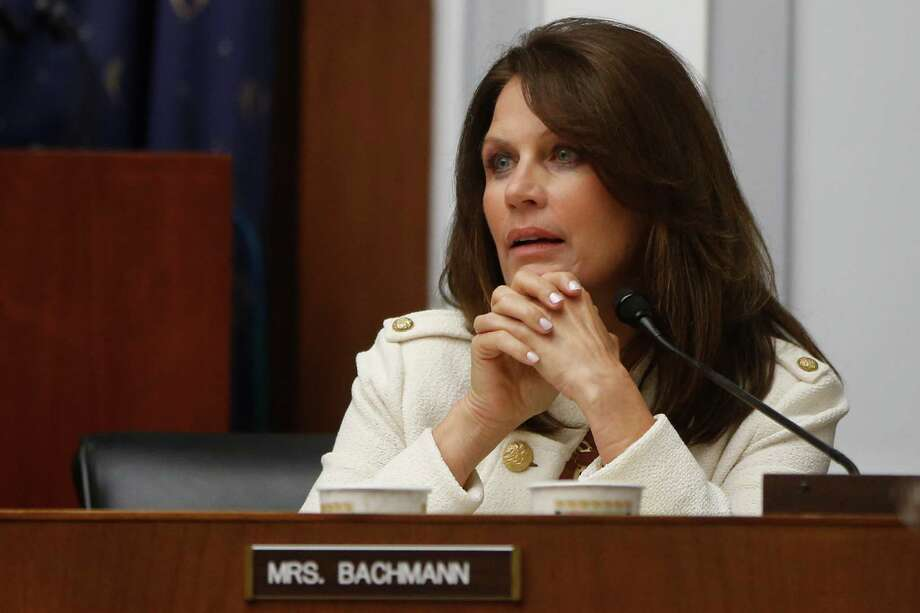 Rep. Michele Bachmann, R-Minn. questions Chairman of the Federal Reserve Ben Bernanke at the House Financial Services Committee on Capitol Hill in Washington, Wednesday, July 17, 2013. (AP Photo/Charles Dharapak) Photo: Charles Dharapak, STF / AP