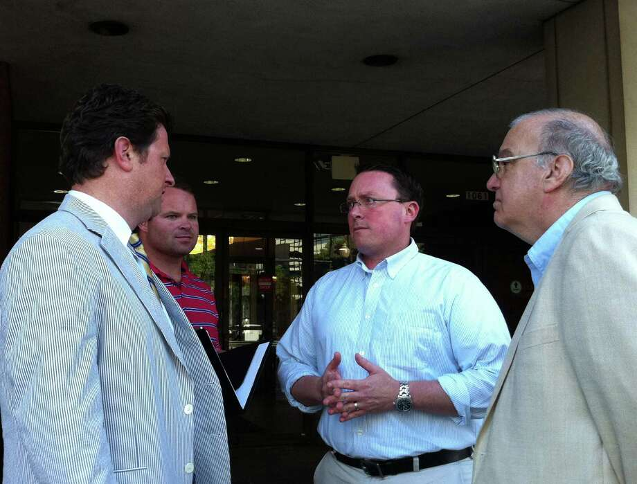 Final arguments in a court appeal over the town's new local voting districts were heard Wednesday. Attorney From left, attorneyRobert Russo talks with Chris Tymniak, a district leader with the Republican Town Committee, RTC Chairman James Millington and Republican Registrar of Voters Roger Autuori. Photo: Genevieve Reilly / Fairfield Citizen