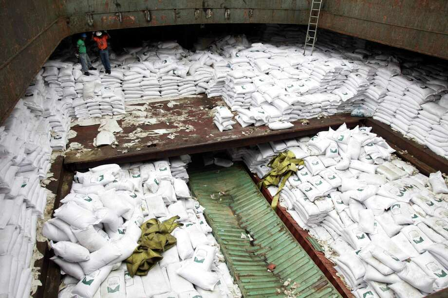 A North Korean-flagged ship carrying weapons system parts buried under sacks of sugar was seized as it tried to cross the Panama Canal on its way from Cuba to its home country, which is under a United Nations arms embargo, Panamanian officials said Tuesday. Photo: Arnulfo Franco, STF / AP