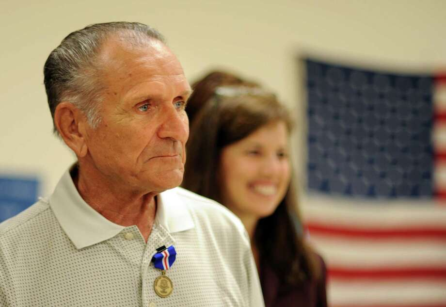 Air Force veteran Alphonse Boudreau, of Milford, wears the Connecticut Veterans Wartime Service Medal Wednesday, July 17, 2013 during a ceremony at the Milford Senior Center to honor veterans of foreign wars for their bravery and service. Photo: Autumn Driscoll / Connecticut Post