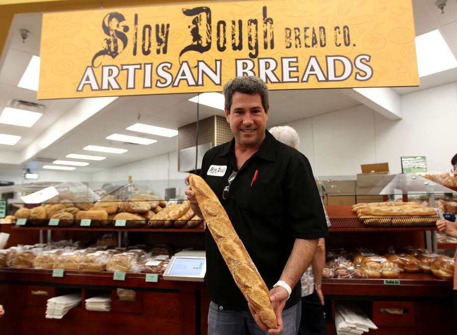 Heath Wendell, co-owner of Slow Dough Bread Company stands next to his display during the grand opening of the Fiesta Market Place at 13833 Southwest Freeway, Wednesday, July 17, 2013, in Houston.  This new Fiesta Market Place in Sugar Creek will offer a number of firsts for a Fiesta store.( Karen Warren / Houston Chronicle )