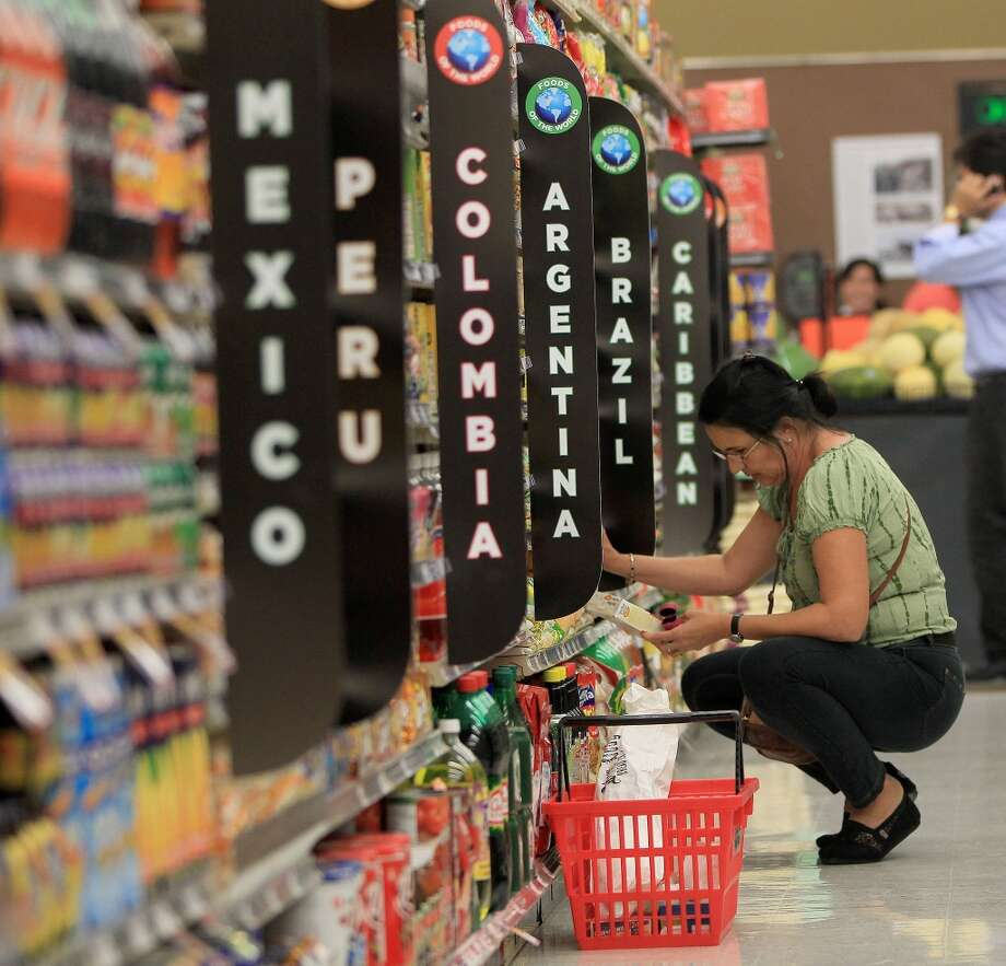 "Customers shop in the ""Foods of the World"" aisle during the grand opening of the Fiesta Market Place at 13833 Southwest Freeway, Wednesday, July 17, 2013, in Houston.  This new Fiesta Market Place in Sugar Creek will offer a number of firsts for a Fiesta store.( Karen Warren / Houston Chronicle )"