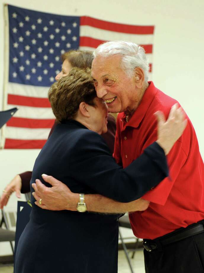 Commissioner of Veterans Affairs Linda Schwartz hugs Marine Corps veteran Philip Pilletere Jr., of Orange, after pinning him with the Connecticut Veterans Wartime Service Medal Wednesday, July 17, 2013 during a ceremony at the Milford Senior Center to honor veterans of foreign wars for their bravery and service. Photo: Autumn Driscoll / Connecticut Post