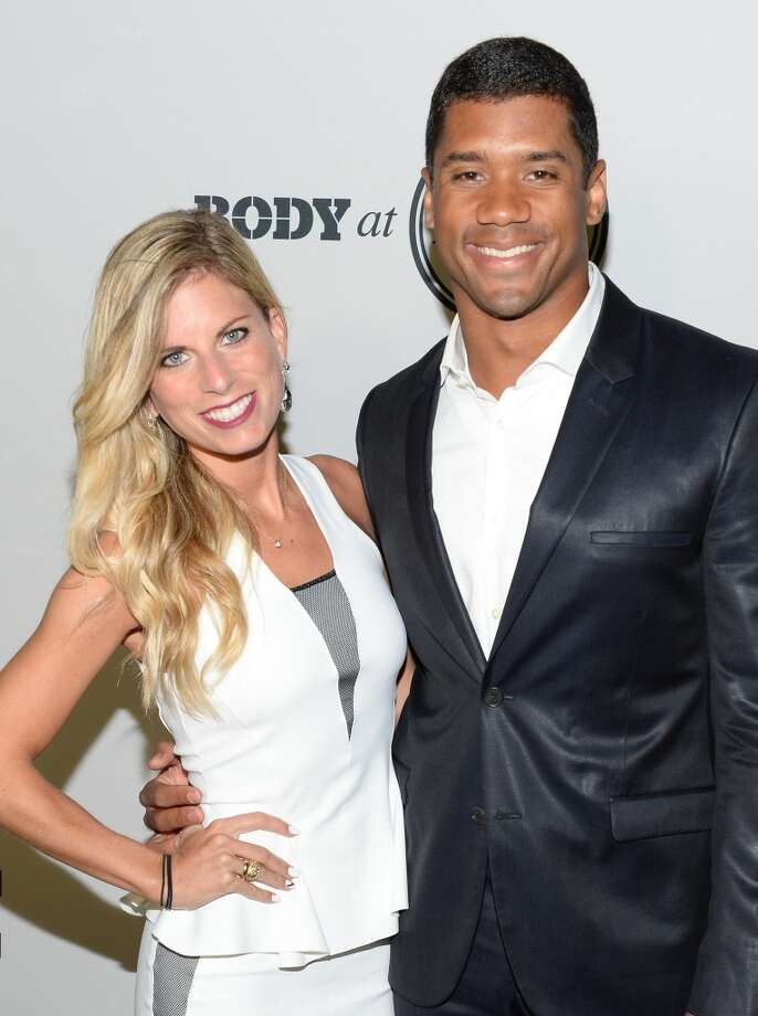 "HOLLYWOOD, CA - JULY 16:  Professional football player Russell Wilson (R) and Ashton Meem attend ESPN the Magazine 5th annual ""Body Issue"" party at Lure on July 16, 2013 in Hollywood, California.  (Photo by Michael Kovac/WireImage)"