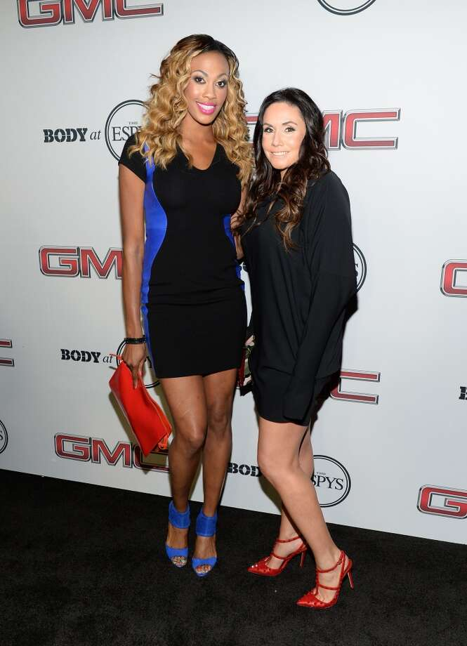 "Professional volleyball players Kim Glass (L) and Lindsey Berg attend ESPN the Magazine 5th annual ""Body Issue"" party at Lure on July 16, 2013 in Hollywood, California.  (Photo by Michael Kovac/WireImage)"