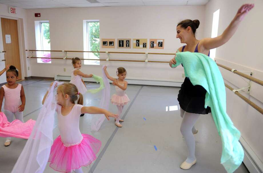 Molly Rigney, 16, of Fairfield, volunteers as a dance instructor at Connecticut Dance School in Fairfield helping to teach children Wednesday, July 17, 2013 during their summer dance program. Photo: Autumn Driscoll / Connecticut Post