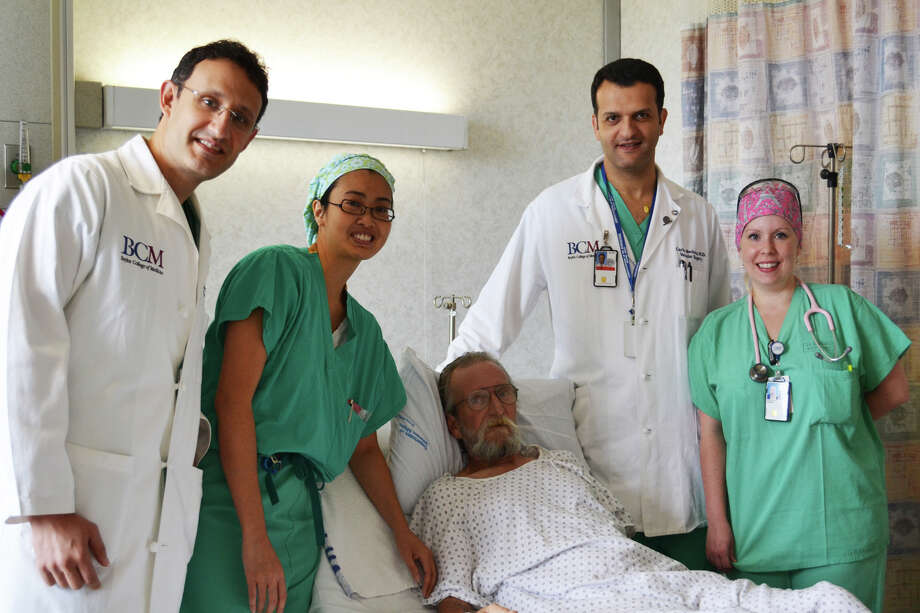 Dr. George Pisimisis, from left, Dr. Thuy Ngo, CRNA Shannon Clark-Murray and Dr. Carlos Bechara check in on patient John Crosby. Photo: Courtesy Of Michael E. DeBakey VA Medical Center