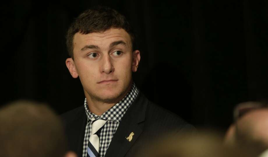 At Wednesday's (July 12, 2013) Southeastern Conference football media day in Hoover, Ala. Johnny Manziel turns up the fashion knob with a pattern play mash-up that's, well, a touchdown. Here's why: black and white have been a big summer trend and going into fall, the color combo will get even bigger. Plus we like a checked shirt especially when it's teamed with a regimental striped tie, this one in black/white/gray. What also works is that the shirt print is small enough to take the stripes in varying widths.