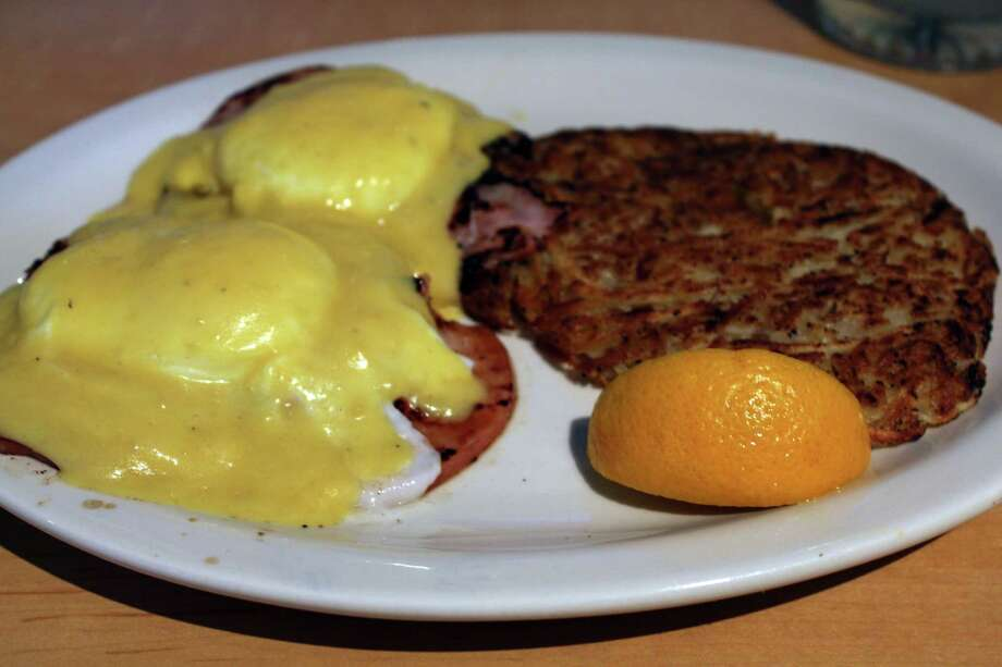 At Pancake Joe's, an order of eggs Benedict comes with two eggs any style, choice of meat (ham shown here), hash browns and fruit or ranch potatoes. Photo: Jennifer McInnis, San Antonio Express-News