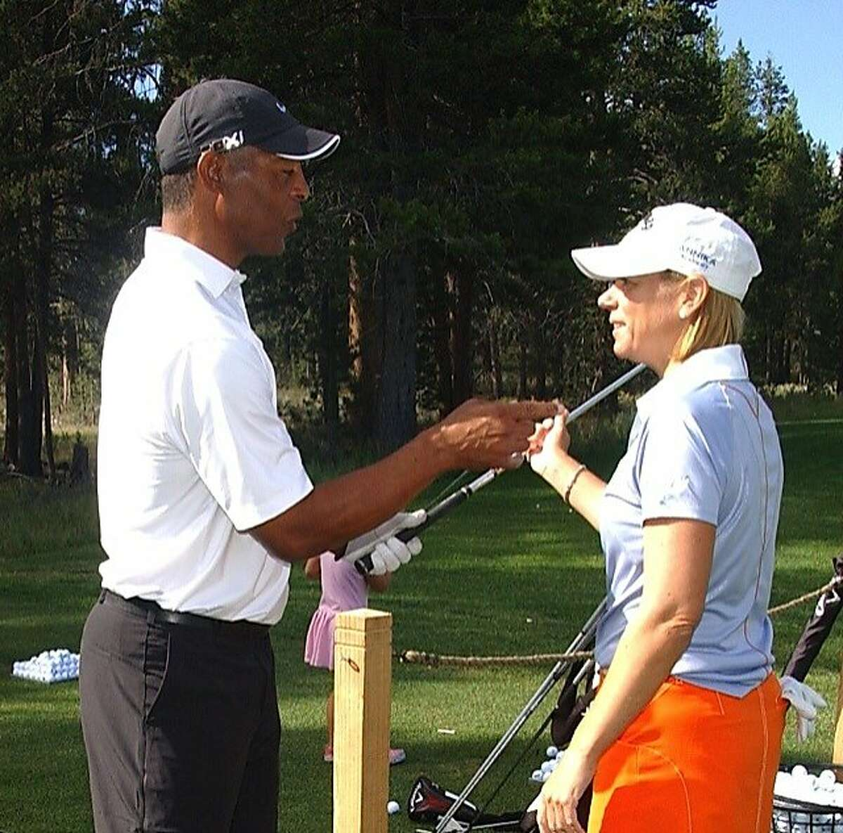 Retired LPGA great Annika Sorenstam gives some coaching tips to former Raider running back Marcus Allen. Friends and colleagues of former Raider player and coach Gene Upshaw gathered in Lake Tahoe for a benefit golf tournament to raise money for brain injury research and Upshaw's cancer treatment center.