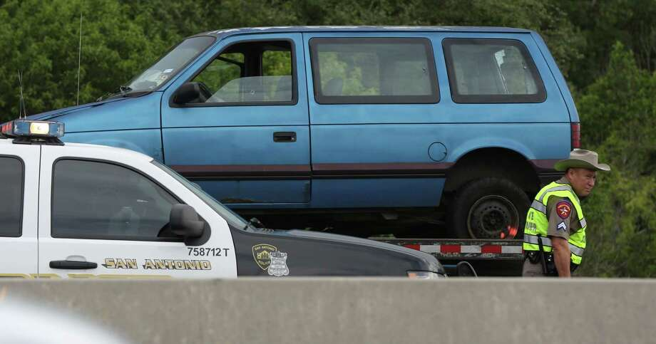 A vehicle involved in a wreck caused by a wrong-way driver on southbound 281 just north of Hildebrand Avenue is seen Wednesday July 17, 2013 after being loaded on to a wrecker.