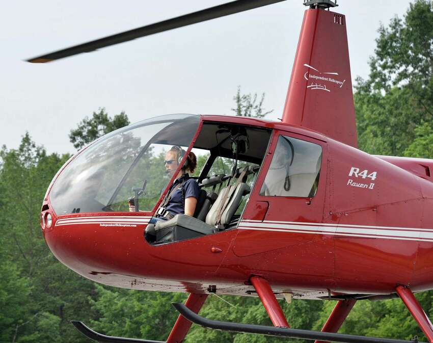 Pilot Heather Howley of Independent Helicopters lands her Robinson R44 helicopter at Saratoga County Airport in Ballston Spa, NY Wednesday July 10, 2013. (John Carl D'Annibale / Times Union)