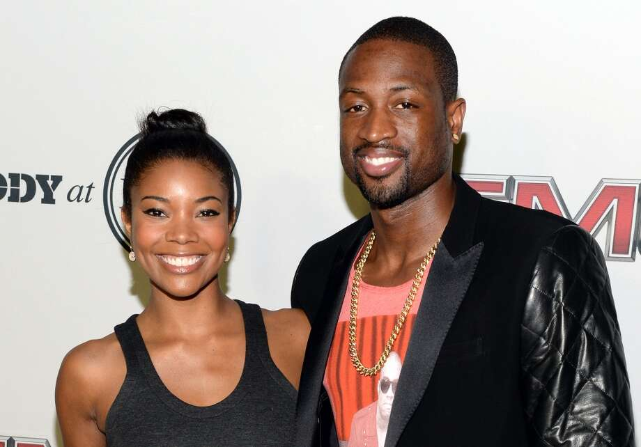 "Actress Gabrielle Union (L) and Professional basketball player Dwyane Wade attend ESPN The Magazine 5th annual ""Body Issue"" party at Lure on July 16, 2013 in Hollywood, California.  (Photo by Michael Kovac/WireImage)"