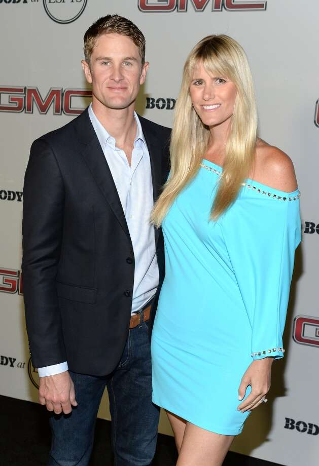 "Professional race car driver Ryan Hunter-Reay (L) and Rebecca Hunter-Reay attend ESPN the Magazine 5th annual ""Body Issue"" party at Lure on July 16, 2013 in Hollywood, California.  (Photo by Michael Kovac/WireImage)"