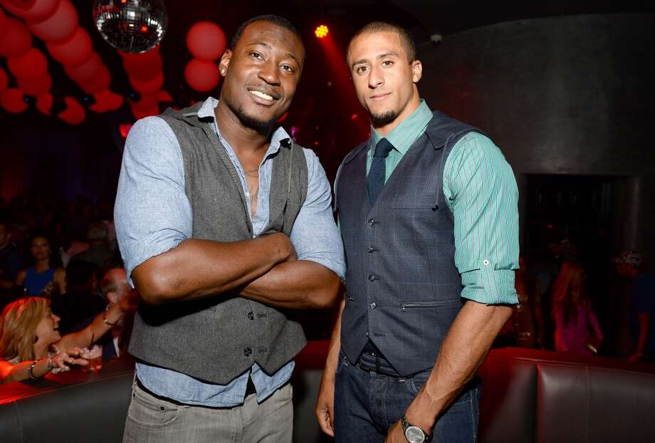 "Professional football players Kourtnei Brown (L) and Colin Kaepernick attend ESPN the Magazine 5th annual ""Body Issue"" party at Lure on July 16, 2013 in Hollywood, California.  (Photo by Michael Kovac/WireImage)"