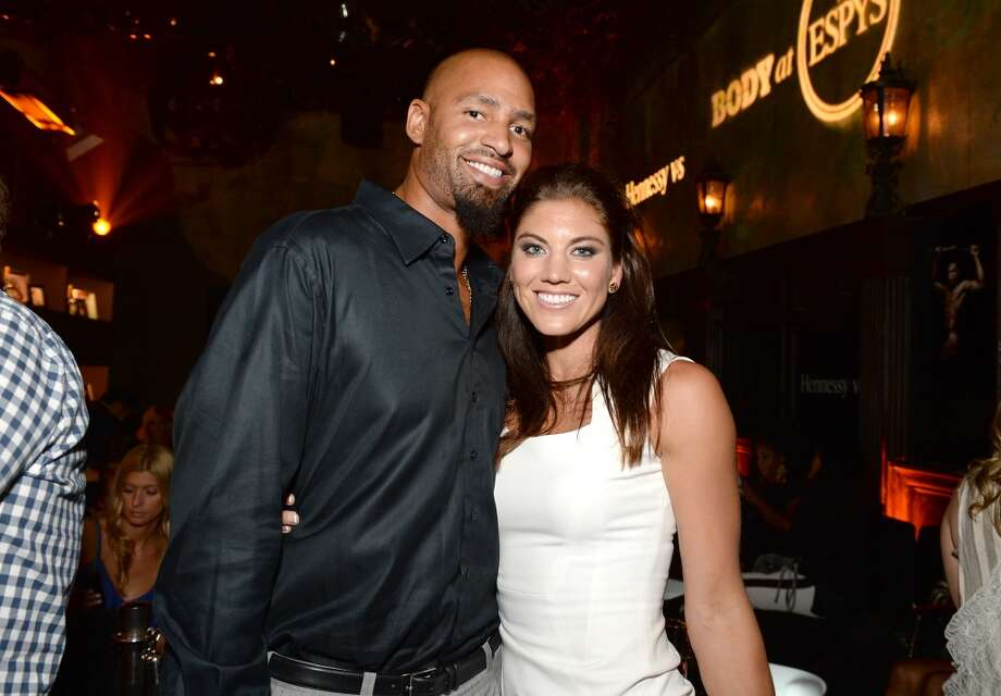 "Professional soccer player Hope Solo (L) and Professional football player Jerramy Stevens attend ESPN the Magazine 5th annual ""Body Issue"" party at Lure on July 16, 2013 in Hollywood, California.  (Photo by Michael Kovac/WireImage)"