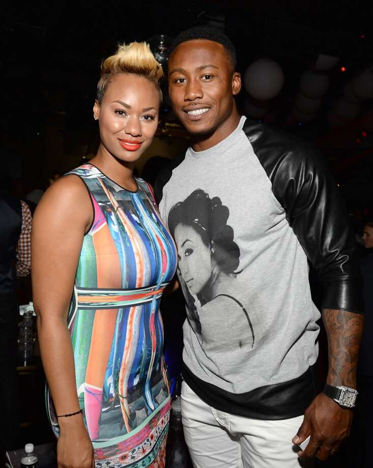 "Professional football player Brandon Marshall (R) and Michi Marshall attend ESPN the Magazine 5th annual ""Body Issue"" party at Lure on July 16, 2013 in Hollywood, California.  (Photo by Michael Kovac/WireImage)"