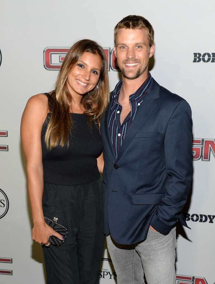 """Pro Surfer Maya Gabeira (L) and actor Jesse Spencer attend ESPN the Magazine 5th annual """"Body Issue"""" party at Lure on July 16, 2013 in Hollywood, California.  (Photo by Michael Kovac/WireImage)"""