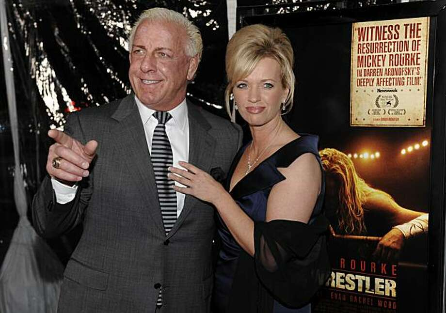 "FILE - In this Dec. 16, 2008 file photo, former pro wrestler Ric Flair and his then girlfriend Jackie arrive at the premiere of the film ""The Wrestler"" at the Academy of Motion Picture Arts and Sciences in Beverly Hills, Calif., Tuesday, Dec. 16, 2008. Photo: Chris Pizzello, AP"