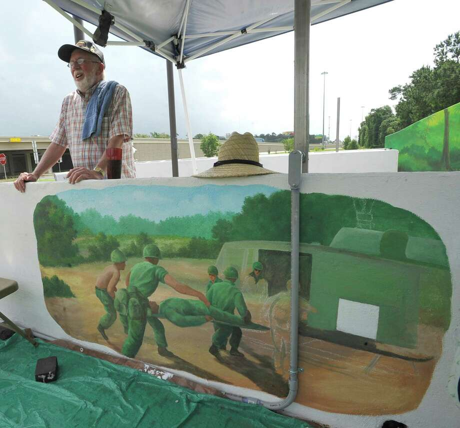 Jerry Gatch, who is head of the Vietnam Veterans chapter in Orange County, is involved in building the new memorial that includes plaques to the 28 Orange County veterans that died in the war at the Vidor Lion's Club Park near Interstate 10.  The park will be officially dedicated August 10, 2013. The walls around the new park are painted with scenes from Vietnam like this one of a wounded soldier being taken to a helicopter.  Dave Ryan/The Enterprise