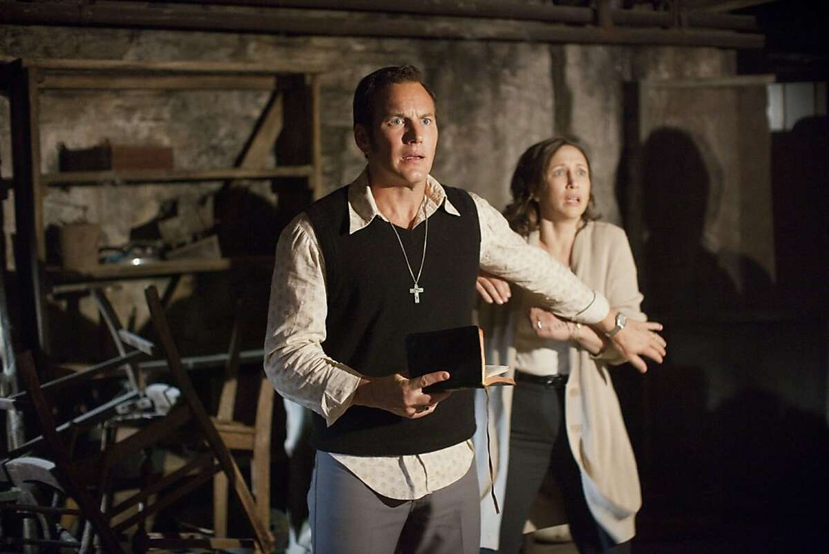 (L-r) PATRICK WILSON as Ed Warren and VERA FARMIGA as Lorraine Warren in New Line Cinema?•s supernatural thriller ?'THE CONJURING,?