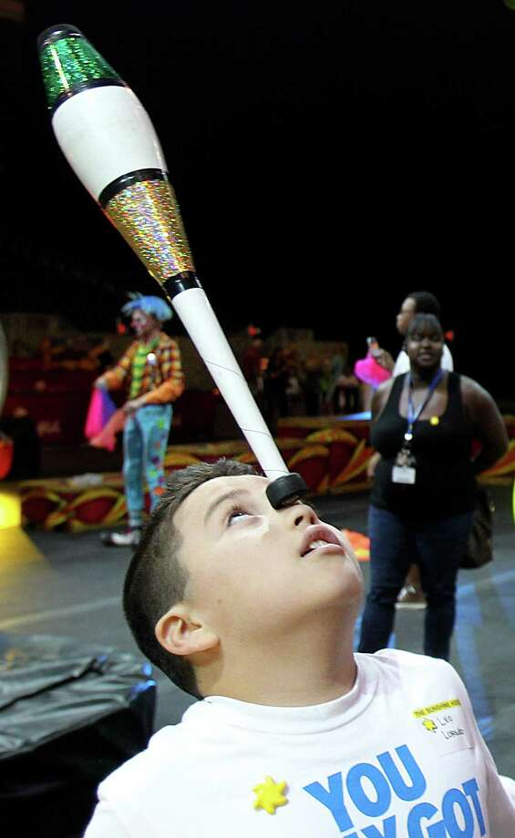Leo Loredo balances a juggling club on his nose during the Clown Jr. College three day camp at Reliant Stadium. Photo: Mayra Beltran / © 2013 Houston Chronicle
