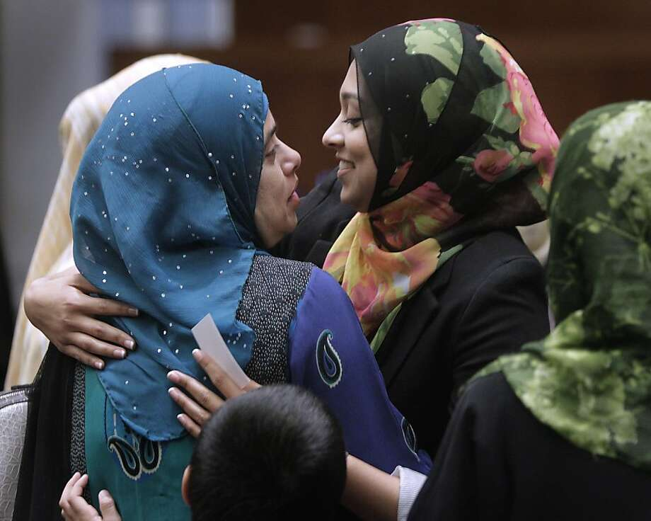 Sadia Saifuddin (right), a Muslim student at UC Berkeley, embraces her mother, Afsham, after her confirmation as a student regent at a meeting of the UC Board of Regents in San Francisco. Photo: Paul Chinn, The Chronicle