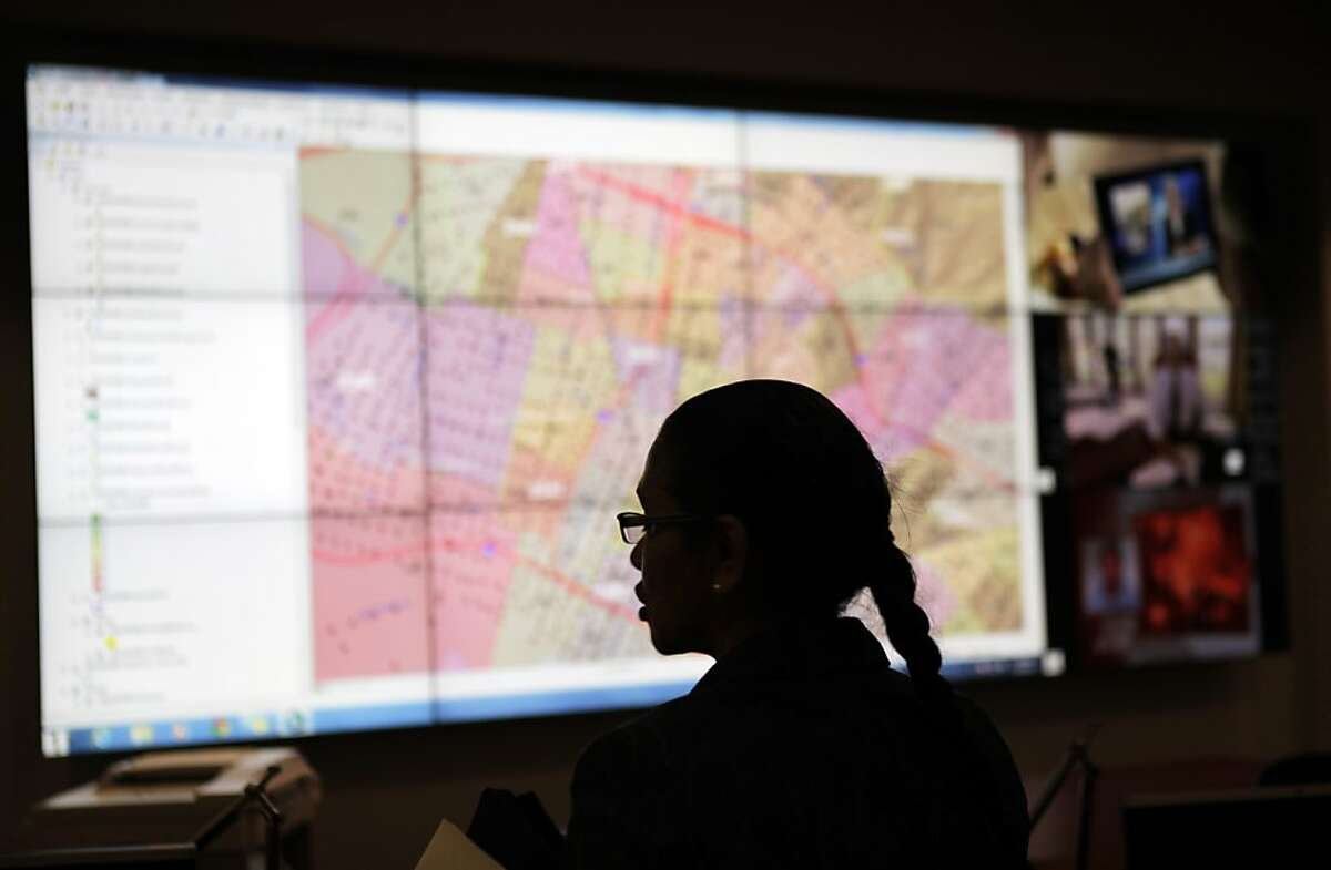 Reneé Domingo, Oakland's Director of Emergency Services, in front of the main monitoring screen at the Domain Awareness Center in Oakland, Calif., on Tuesday, July 16, 2013. The DAC will soon combine emergency data and information sets from city police, fire, the Port of Oakland, among others in 2014.