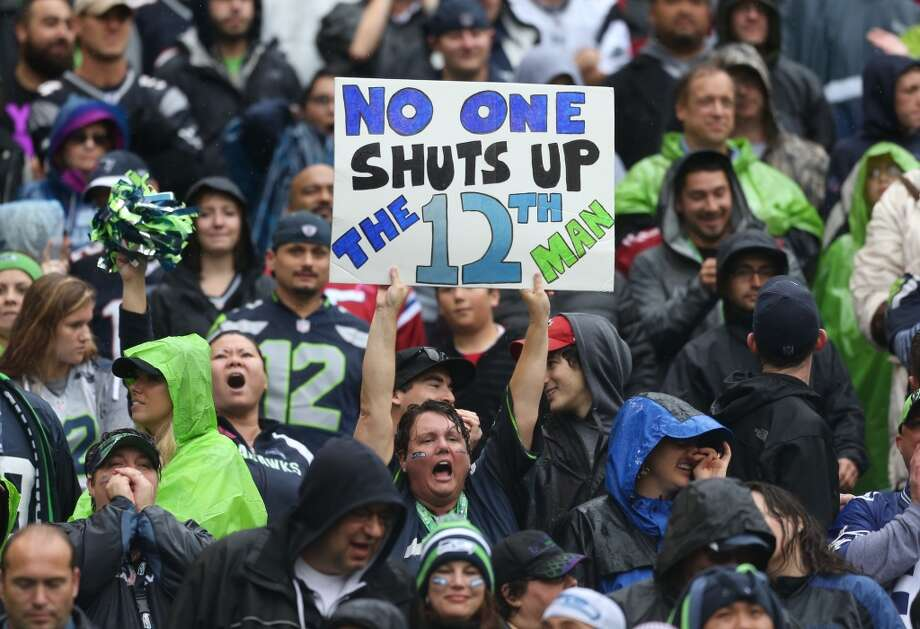 Many fans make sure to wear home jerseys when the Seahawks are home and away jerseys when the team is away. Some fans make sure to wear their hat forward when the Seahawks are on offense and backward when they're on defense. Other fans need to have one blue sock, one green sock, Seahawks sweatpants, a 12th Man T-shirt, a crazy hat, a neck full of bead necklaces and a Seahawks tumbler filled with their special game-day beer. One thing is clear: It matters what you wear.