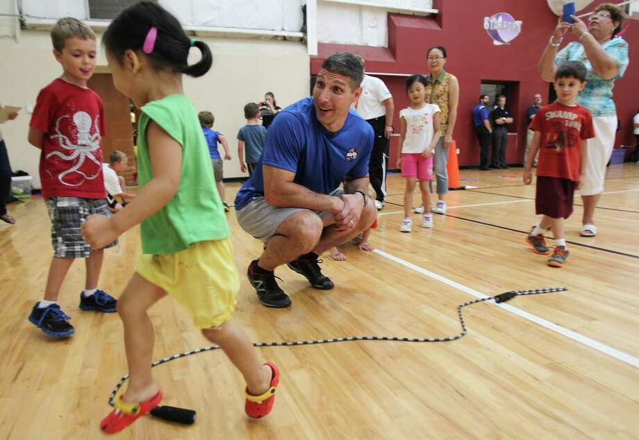 NASA astronaut Mike Hopkins is impressed by the campers jumping skills as they complete the 'jump to the moon' exercise while they learn how astronauts get physically ready to travel to space at Johnson Space Center on Wednesday, July 17, 2013, in Houston. Photo: Mayra Beltran / © 2013 Houston Chronicle