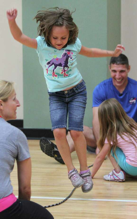 Remington Merill jumps rope as she completes the 'jump to the moon' exercise where campers learn how astronauts get physically ready to travel to space at Johnson Space Center on Wednesday, July 17, 2013, in Houston. Photo: Mayra Beltran / © 2013 Houston Chronicle