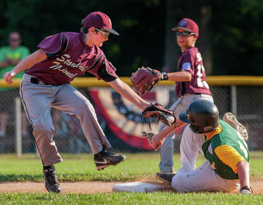 Stamford National shortstop Shane Hackett can't get the tag on Edgewood's Noah Plantamuro in time and the runner was safe at second during a section 1 little league game played at McGuane Field, Darien, CT on Wednesday Jily 17th, 2013. Photo: Mark Conrad / Stamford Advocate Freelance