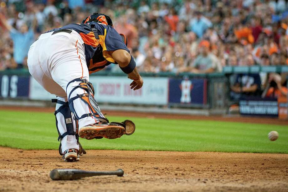 Defense is one of many deficiencies for the Astros, who have committed an MLB-high 70 errors, including one on an errant throw to catcher Carlos Corporan. Photo: Smiley N. Pool / © 2013  Smiley N. Pool
