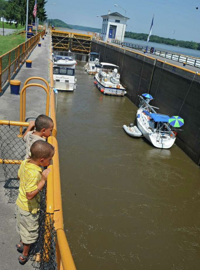 Six-year-old twin brothers, Wilhem, front, and Erik Reichmeider of Houston, Texas, watch as boats enter lock 7 Wednesday, July 17, 2013, in Niskayuna, N.Y. The remainder of the state canal system reopened on Wednesday. (Lori Van Buren / Times Union) Photo: Lori Van Buren / 00023215A