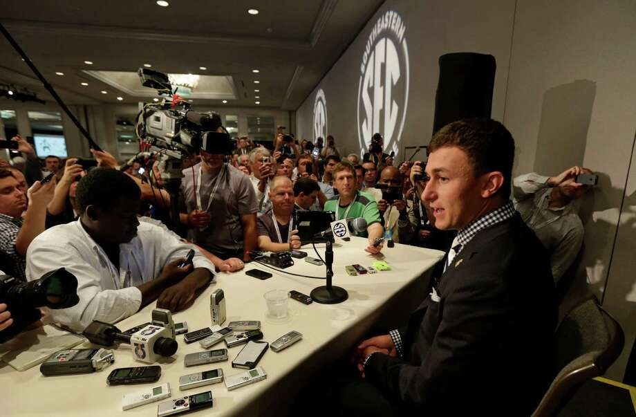 Johnny Manziel said he felt comfortable dealing with the vast amount of media attention he received Wednesday. Photo: Dave Martin, STF / AP