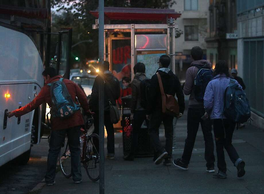 A shuttle going to the Google campus loading passengers on the 24th at Valencia street bus stop in San Francisco, Calif., on Tuesday, October 23, 2012.  San Francisco supervisor John Avalos has introduced legislation to regulate these private shuttles. Photo: Liz Hafalia, The Chronicle