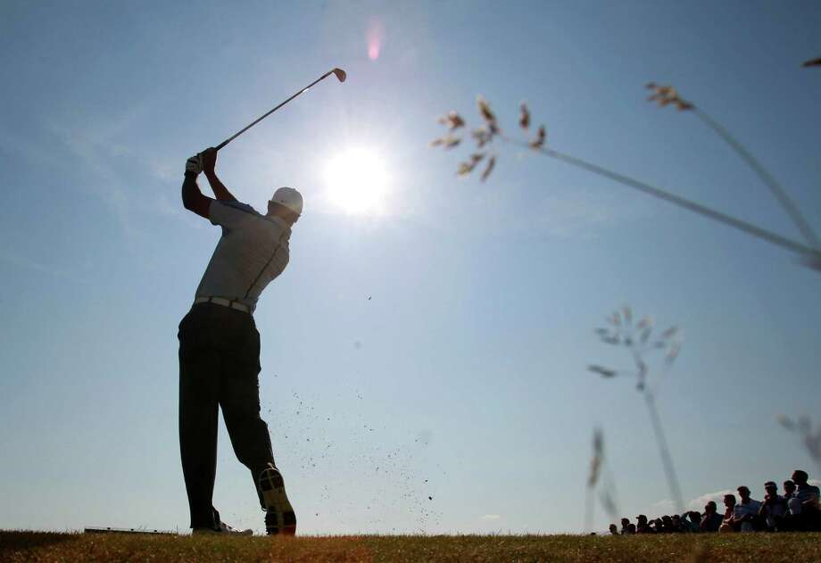 Tiger Woods likes the open spaces of British Open links courses because they allow golfers to hit shots they normally must avoid on American-style courses. Photo: Peter Morrison, STR / AP