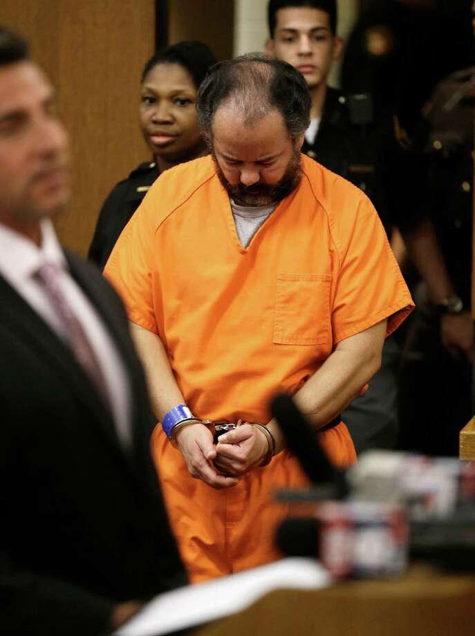 Ariel Castro enters the courtroom during his arraignment on an expanded 977-count indictment Wednesday, July 17, 2013, in Cleveland. Castro is charged with kidnapping and raping three women over a decade in his Cleveland home. He pleaded not guilty to 512 counts of kidnapping and 446 counts of rape. (AP Photo/Tony Dejak) ORG XMIT: CD102 Photo: Tony Dejak / AP