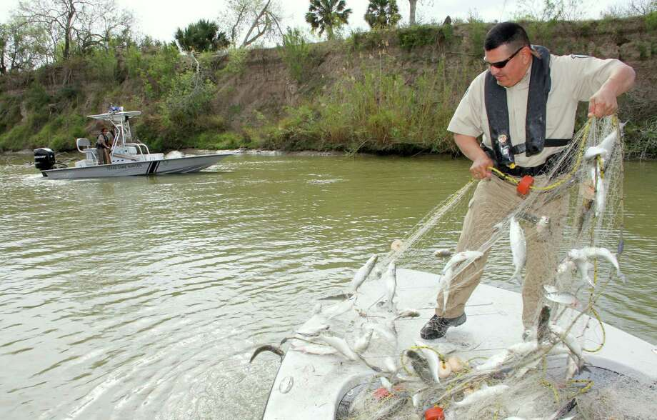 Calls to the Operation Game Thief hot line often point Texas game wardens to illegal gill nets. The 32-year-old program has been responsible for more than 9,000 criminal cases. Photo: Shannon Tompkins, HC Staff / Houston Chronicle