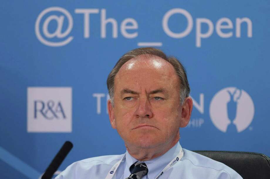 The Royal and Ancient Golf Club's Chief Executive Peter Dawson listens during a press conference ahead of the British Open Golf Championship at Muirfield, Scotland, Wednesday July 17, 2013. (AP Photo) ORG XMIT: MUI196 / AP