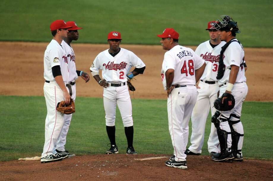 Tri-City ValleyCats manager Ed Romero meets with his team at the mound during their game against Auburn at Joe Bruno Stadium on Wednesday July 17, 2013 in Troy, N.Y.  (Michael P. Farrell/Times Union) Photo: Michael P. Farrell / 00023161A