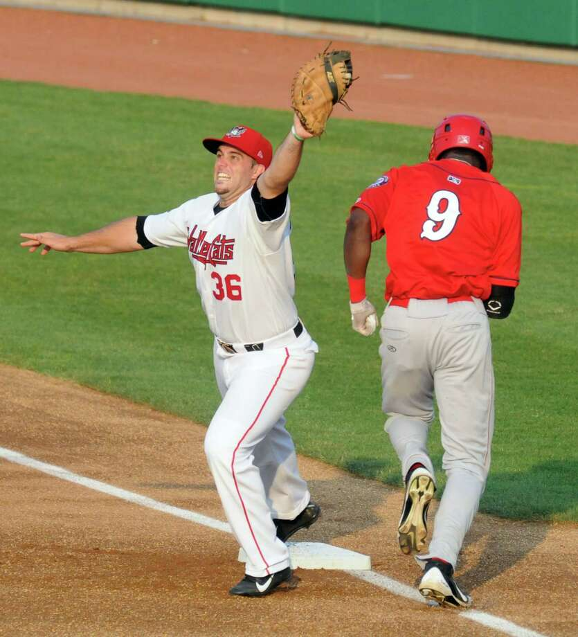 Tri-City ValleyCats Michael Martinez grabs a high throw to first for an out during their game against Auburn at Joe Bruno Stadium on Wednesday July 17, 2013 in Troy, N.Y.  (Michael P. Farrell/Times Union) Photo: Michael P. Farrell / 00023161A