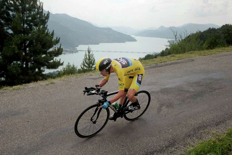 Stage winner Christopher Froome of Britain, wearing the overall leader's yellow jersey, passes lake Serre-Poncon during the seventeenth stage of the Tour de France cycling race an individual time trial over 32 kilometers (20 miles) with start in Embrun and finish in Chorges, France, Wednesday July 17, 2013. (AP Photo/Laurent Cipriani) ORG XMIT: PDJ127 Photo: Laurent Cipriani / AP