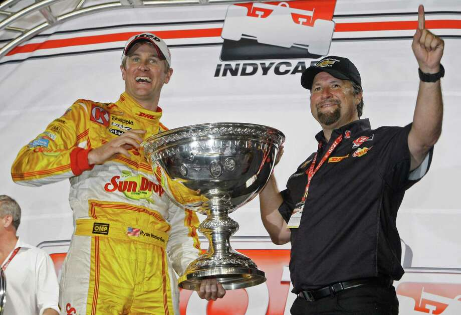 FILe - In this Sept. 15, 2012 file photo, Ryan Hunter-Reay, left, and team owner Michael Andretti celebrate his season victory in the MAVTV IndyCar World Championships auto race at Auto Club Speedway in Fontana, Calif. Andretti Autosport announced Wednesday, July 17, 2013, it has signed on as the third team to compete in the environmentally friendly FIA Formula E championship, which will feature electric cars racing in 10 cities around the world beginning in 2014.  Michael Andretti's two-car operation will join China Racing and British-based Drayson Racing as organizations already committed to a field that will have 10 two-car teams competing in each e-Prix. (AP Photo/Reed Saxon, File) ORG XMIT: NY152 Photo: Reed Saxon / AP
