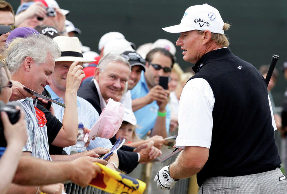Ernie Els of South Africa signs autographs for fans during a practice round ahead of the British Open Golf Championship at Muirfield, Scotland, Wednesday July 17, 2013. (AP Photo/Jon Super) ORG XMIT: MUI185 Photo: Jon Super / AP