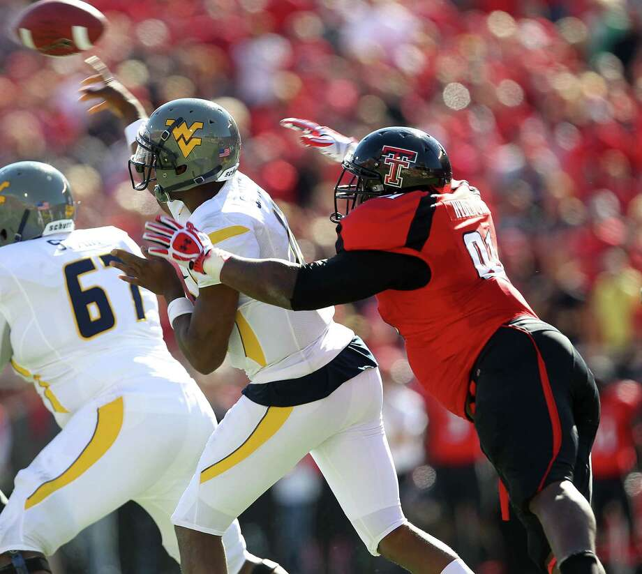 Texas Tech DL Kerry HyderPHOTO: West Virginia's Geno Smith throws under pressure from Hyder in Lubbock, Oct. 13, 2012. Photo: Stephen Spillman, AP Photo/Lubbock Avalanche-Journal / Lubbock Avalanche-Journal