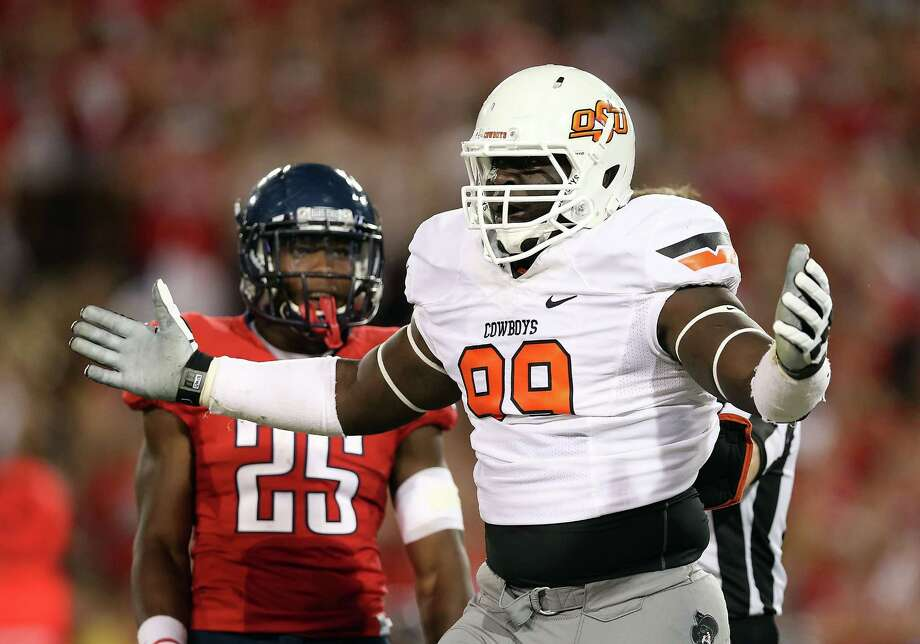 Oklahoma State DL Calvin BarnettPHOTO: Barnett reacts to a penalty call during a game against the Arizona Wildcats at Arizona Stadium on Sept. 8, 2012, in Tucson, Ariz. Photo: Christian Petersen, Getty Images / 2012 Getty Images