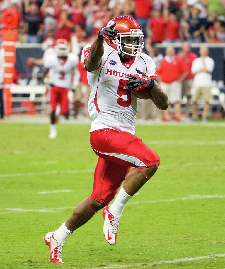 NEWCOMER OF THE YEAR: West Virginia RB Charles SimsPHOTO: Sims, seen with Houston last season, races to the end zone on a 47-yard touchdown run against Rice at Reliant Stadium, on Sept. 29, 2012, in Houston. Photo: Smiley N. Pool, Houston Chronicle / © 2012  Houston Chronicle